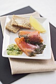 Slices of gravadlax with mustard & dill sauce & wholemeal bread