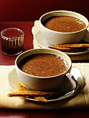 Two cups of hot chocolate with spice cake fingers