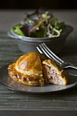 Goose liver pie with green salad
