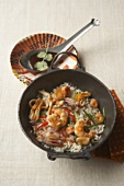 Seafood stir-fry with jasmine rice, mangetout and peppers