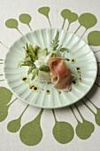 Asparagus salad in bread case with Parma ham