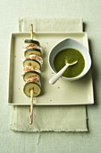 Sesame-coated cod & courgette slices on skewer with pesto