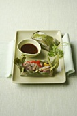Duck breast with soya bean sprouts, chilli baked in banana leaf