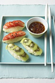 Sweet kiwi fruit and strawberry sushi with spicy dip