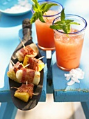 Grilled bacon-wrapped banana & pineapple with melon drink