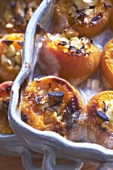 Baked, stuffed apricots in baking dishes