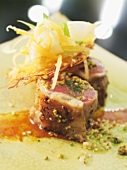Braised slices of loin of lamb with fried potato cake