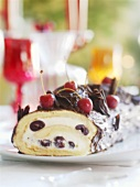 Chocolate-coated sponge roll with mascarpone & cherry cream