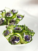 Cucumber rolls filled with sour cream and caviar