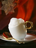 Coffee mousse with milk froth in a cup