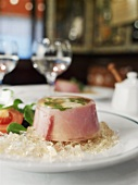 Egg in aspic with ham in a restaurant