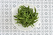 Cooked green beans in a dish
