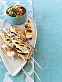 Grilled fish kebabs with vegetable salad