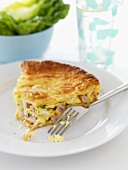 A piece of ham and leek pie