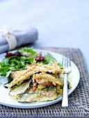 Courgette gratin with salad leaves