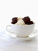Chocolate-dipped nut meringues in a cup