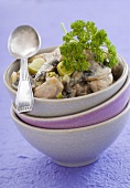Blanquette of veal with leeks and mushrooms in a bowl