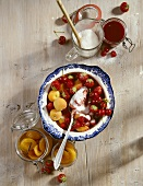 Mixed fruit and sugar in a bowl, for bottling or jam
