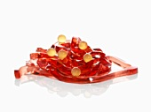 Molecular cuisine: Campari tagliatelle with orange juice spheres
