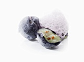 Molecular cuisine: frozen blueberry with foam