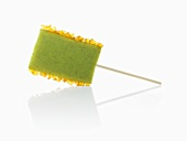 Molecular cuisine: kiwi fruit lollipop with candied orange