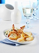 Halved, fried prawns with risotto and white wine