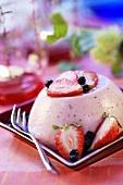Strawberry panna cotta with fresh strawberries