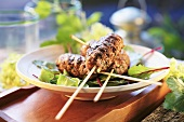 Grilled mince kebabs on beetroot leaves