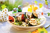Grilled vegetables kebabs on frisee