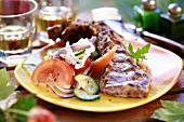 Grilled lamb ribs with salad