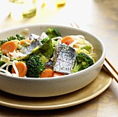 Udon noodles with broccoli, carrots and bass