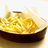 Home-made chips on kitchen paper