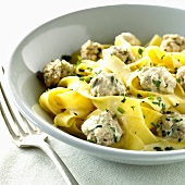 Veal meatballs with ribbon pasta in cream sauce