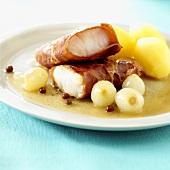 Fried bacon-wrapped cod, silverskin onions, potatoes