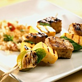 Two grilled tofu and mango kebabs