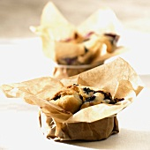 Small blueberry cakes baked in baking parchment