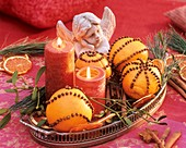 Oranges studded with cloves, candles and an angel