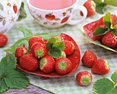 Fresh strawberries in a strawberry dish, tea