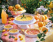 Several puff pastry tarts with citrus fruit fillings, outdoors