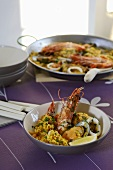 Paella in a dish and in a paella pan