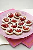 Strawberry and custard tartlets on a plate