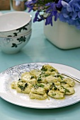 Herb gnocchi with sage butter on a plate