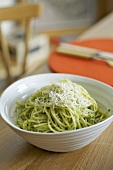 Spaghetti with herb & caper sauce and Parmesan in dish
