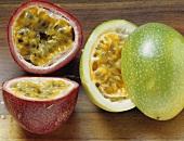 Halved purple granadilla and granadilla (passion fruit)