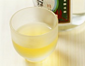 Rice wine in a bottle and a sake cup