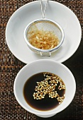 Sesame soy sauce, bonito flakes in a sieve