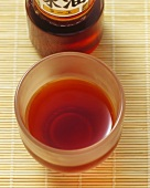 Chilli oil in a bottle and in a small dish