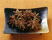 Several star anise in a dish
