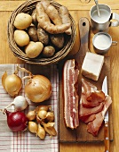 Still life: bacon, onions, potatoes and sour cream