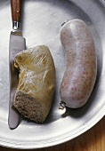 Liver sausage and knife on a pewter plate